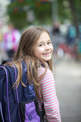 Happy little girl going back to school