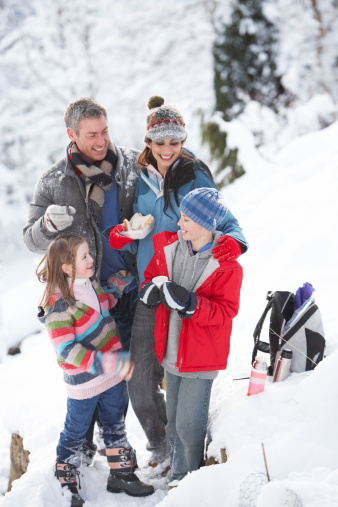 Family spending time not money during winter holidays.