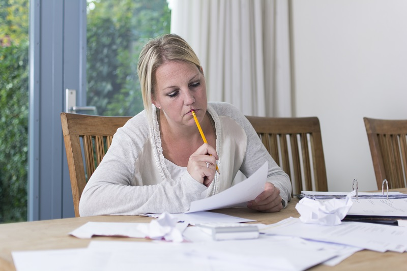 Woman tries to organize finances to help with financial problems