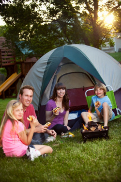 A family camping in their backyard as part of their staycation.